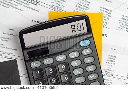 Calculator With The Text Roi - Return On Investment On Display. Business, Tax And Financial Concept