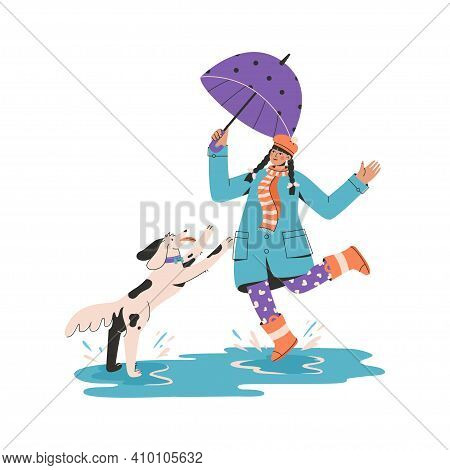 Young Girl With Umbrella Playing With Puppy And Splashing In Puddle