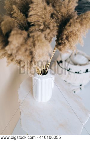 Dried Flowers Spikelets Pampas In White Vase On On A Marble Table.