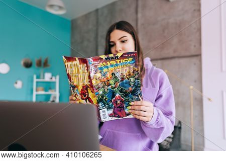 Young Woman Reading Comic Books At Home. Rostov-on-don, Russia. 19 February 2021