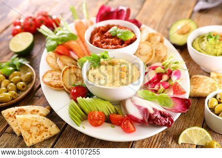 various raw vegetable and dipping sauce