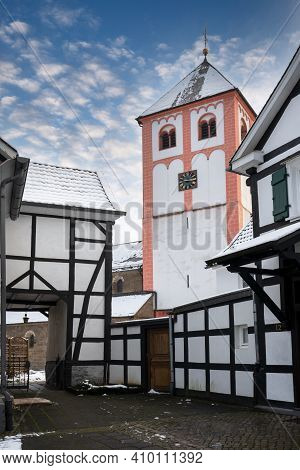 Center Of Village Odenthal With Parish Church And Old Buildings On A Winter Day, Germany