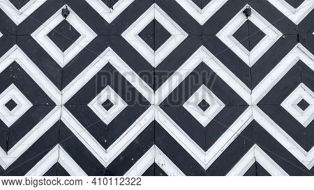 Black And White Pattern In The Form Of Rhombuses On A Wooden Surface. Symbolic Texture.