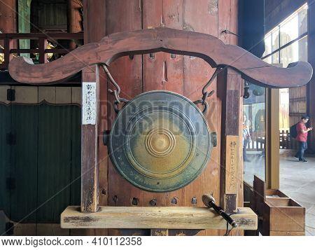 Nara, Japan - April 15, 2018: Gong And A Wooden Gavel At Todai-ji Temple, Nara. Todai-ji Temple Is C