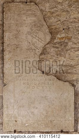 San Giorgio Di Valpolicella, Italy - 02 22 2021: Epigraph On Marble Slab In The Cloister Of The Hist
