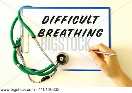 Doctor Makes The Inscription Difficult Breathing. Folder And Stethoscope On A White Background. Medi