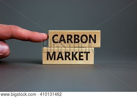 Carbon Market Symbol. Concept Words 'carbon Market' On Wooden Blocks On A Beautiful Grey Background,