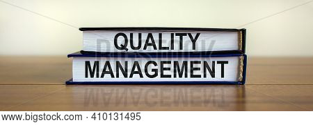 Quality Management Symbol. Concept Words 'quality Management' On Books On A Beautiful Wooden Table,