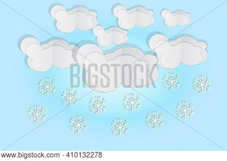 Paper Cut Clouds With Snowflakes On Blue Sky Background. Origami Art Snowing Season. Forecast Concep