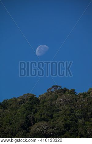 Moon Above Mountain At Day Time