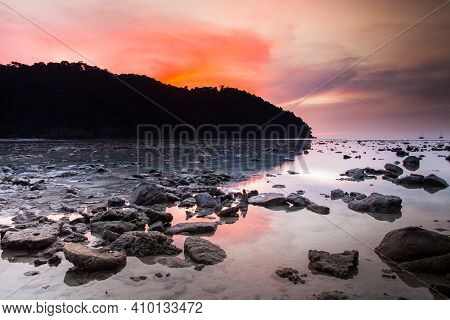 Colorful Sky Beach And Rock At Sunset Time