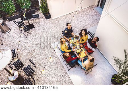 High Angle Top View Of Happy Friends Drinking Cocktails And Having Fun At Restaurant Garden Party -