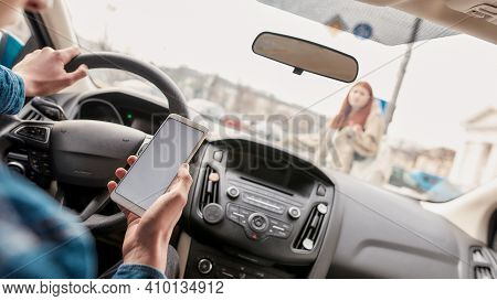 Distracted Young Male Driver Using His Mobile Phone While Running Over A Pedestrian. Technology And