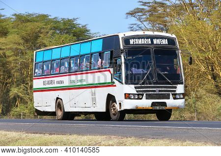 Rift Valley Province, Kenya - January 31, 2021: White Intercity Coach Bus At The Interurban Road.