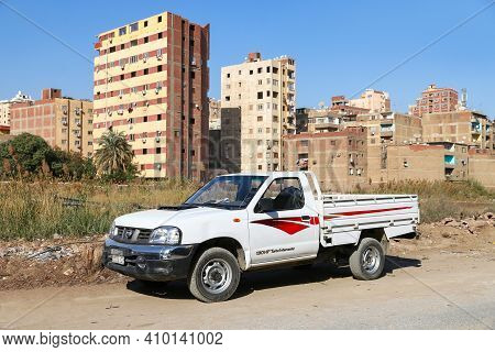Cairo, Egypt - January 26, 2021: White Truck Nissan Pick Up (d22) In The City Street.