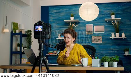 Influencer Sitting At Home Vlog Station While Camera Recording New Podcast. Online Show On-air Produ