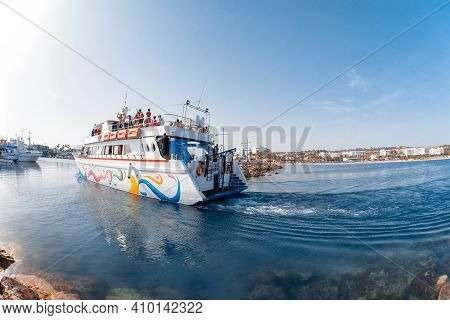Agia Napa, Cyprus - August 10 2019: Cruise Boat With Tourists Enters Port
