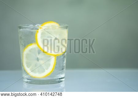 Cold Water With Fresh Lemonade Slice In Glasses. Cold Summer Drink