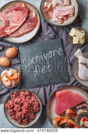 Carnivore Diet Concept. Raw Ingredients For Zero Carb Diet - Fish, Seafood, Eggs, Meat And Animal Fa