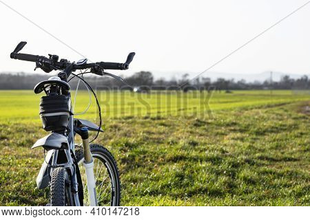 A Bicycle Handlebar Seen From The First Person Perspective. Visible Bicycle Frame And Bicycle Access