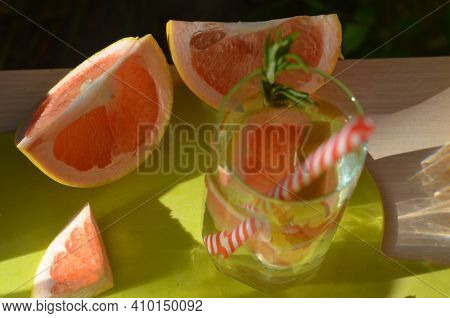Girl Cooking Healthy Detox Smoothie With Fresh Fruits And Green Rosemary Grapefruit Water. Lifestyle