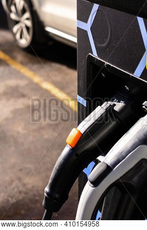 Electro Charging. Recharging For Electric Cars. Refueling An Electric Car