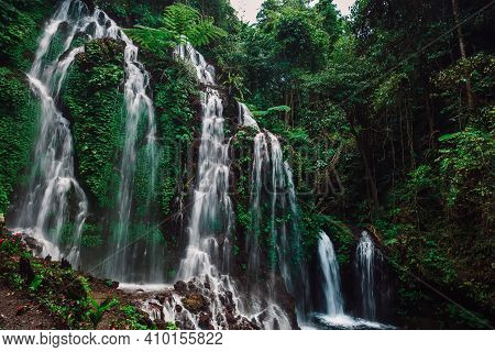 Cascade Waterfall In Tropical Jungle In Indonesia