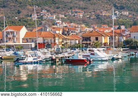 Mediterranean Town At Foot Of Mountain, Fishing Boats In Harbor. Montenegro, Adriatic Sea. Marina Ka