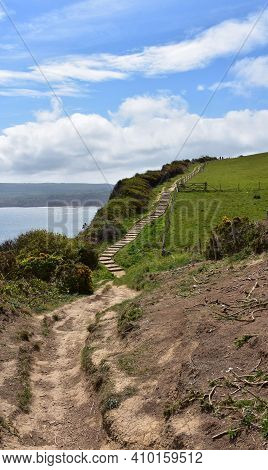 Dirt Trail With Stairs Tracking Along The Sea Cliffs In England.