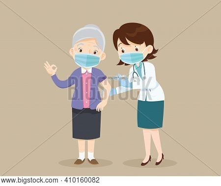 Doctor Injection Vaccine For Elderly Woman, Doctor In A Clinic Giving A Coronavirus Vaccine To Old W