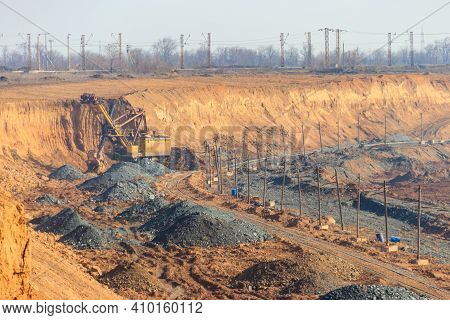 Big Yellow Excavator Working In Iron Ore Quarry