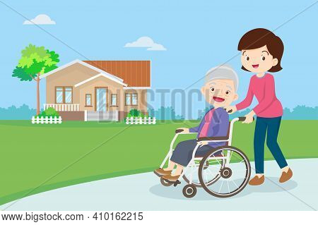 Young Woman Strolling With Elderly Woman In Wheelchair, Nursing Care For Disabled People And Elderly
