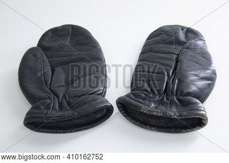 Black Leather Mittens For Winter On A White Background.