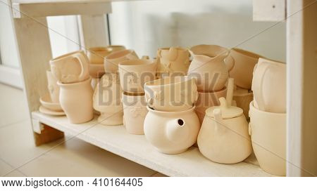 Clay Pottery Ceramic Products Dry On Shelf In Workshop Before Coating. Handmade And Hobby Lifestyle