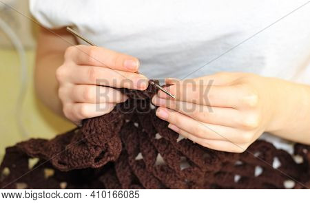 Crochet Products Made Of Brown Yarn. Women's Hobby. Close-up, Selective Shot.
