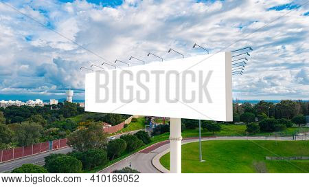 Blank Billboard Ready To Use For Mockup Advertisement On The Background Of The City. Billboard White