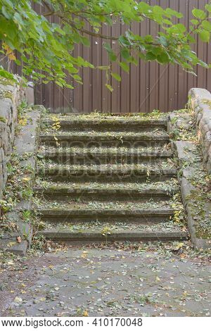 Stone Steps Leading Into Blank Fence. Wrong Path Chosen.