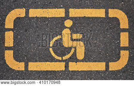 Wheelchair, Handicapped Or Accessibility Parking Or Access Sign Flat Yellow Sign Printed On Asphalt