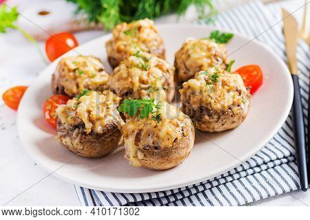 Baked Mushrooms Stuffed With Chicken Minced Meat, Cheese And Herbs On Light Plate.