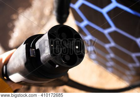 Refueling An Electric Car. Charging An Electric Vehicle. Car Charging Socket