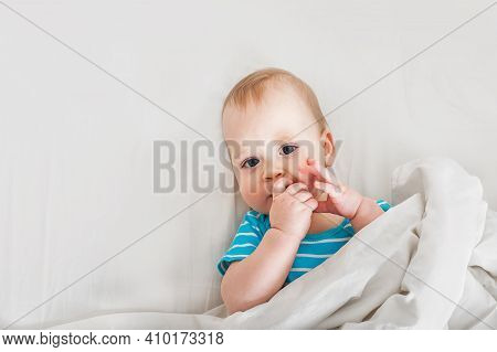 Portrait Of Baby 11 Months Old On Bed Close Up. Funny Kid On White Cloth. Restful Sleep Concept, Tee