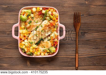 Homemade Baked Chicken With Different Seasonings And Vegetables On A Dark Wooden Background.
