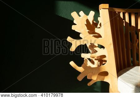 Wooden Chair Against The Background Of A Green Wall. Beautiful Back Of The Chair.