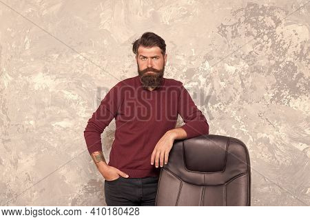 Beard Still Stays In Fashion. Brutal Hipster Stand At Office Chair. Bearded Man With Fashion Look. M