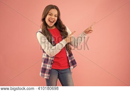 Dont Just Walk Past. Happy Girl Pointing At Pink Background. Little Kid With Pointing Gesture. Index