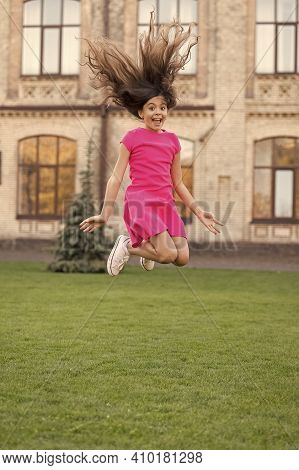 Salon Making Hair More Vital And Energetic. Little Child Jump Summer Outdoor. Active Girl With Long