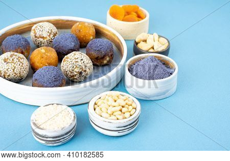 Homemade Blue Matcha Butterfly Pea Tea Powder Energy Balls In A Ceramic Bowl On A Top View Backgroun