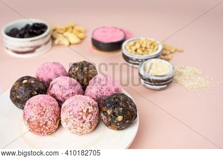 Homemade Pink Matcha Dragon Fruit Energy Balls, Top View, Healthy Sweets Made Of Nuts And Date, Prun
