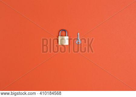 Lock And Key On Orange Background Symbol, Unlock, Winner