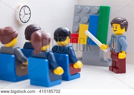 Tambov, Russian Federation - February 26, 2021 Lego Businesspeople Minifigures Having A Meeting And